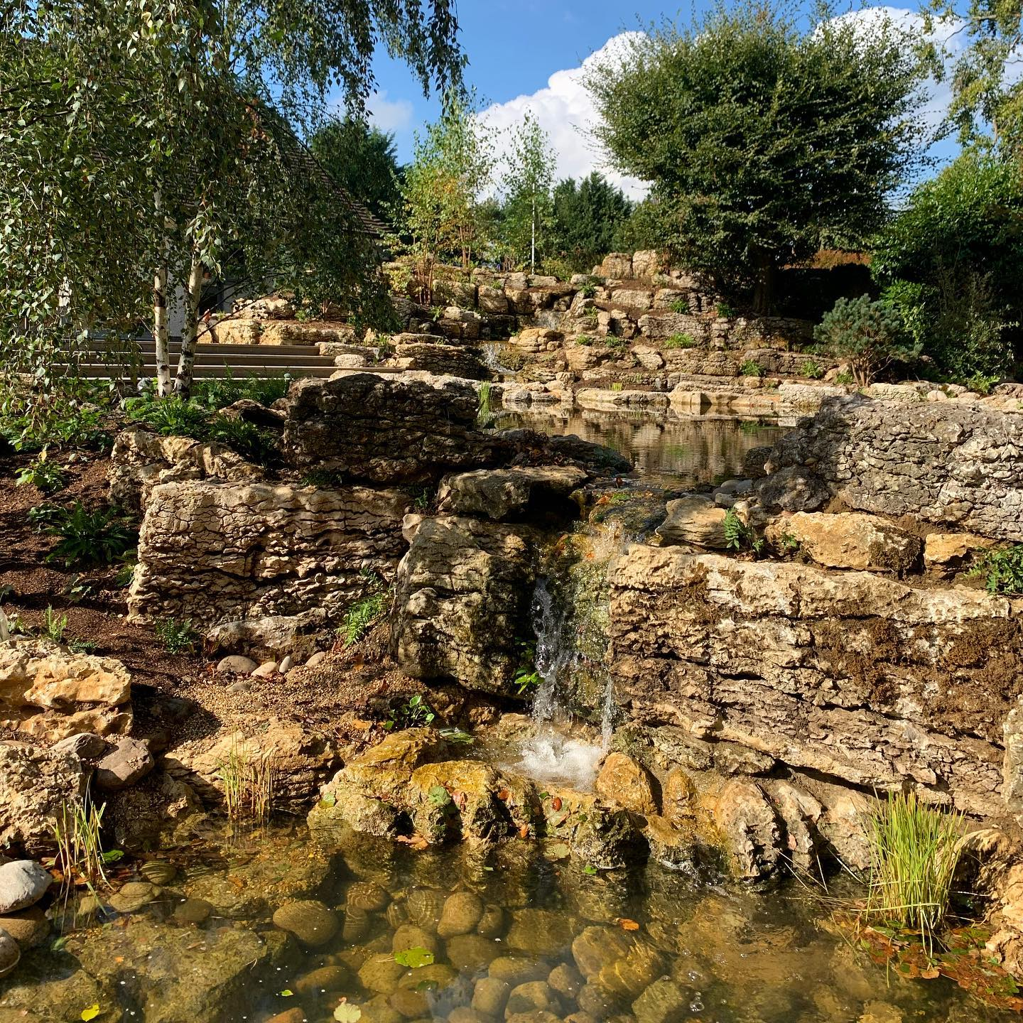 Waterfalls running crystal clear on our Surrey project. just a little more greening needed... @waterartisans @belderboslandscapes